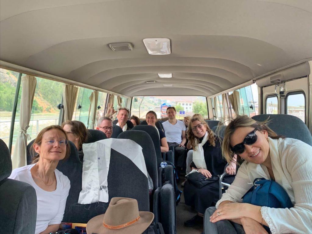 Students on the Elton Yoga Bhutan Yoga Adventure touring Bhutan by bus.