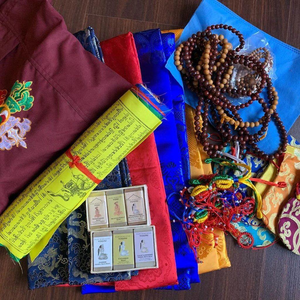 Essential dharma items like a kata, prayer flags, mala, Wild Earth yogi soap, journal and a dharma bag to carry everything