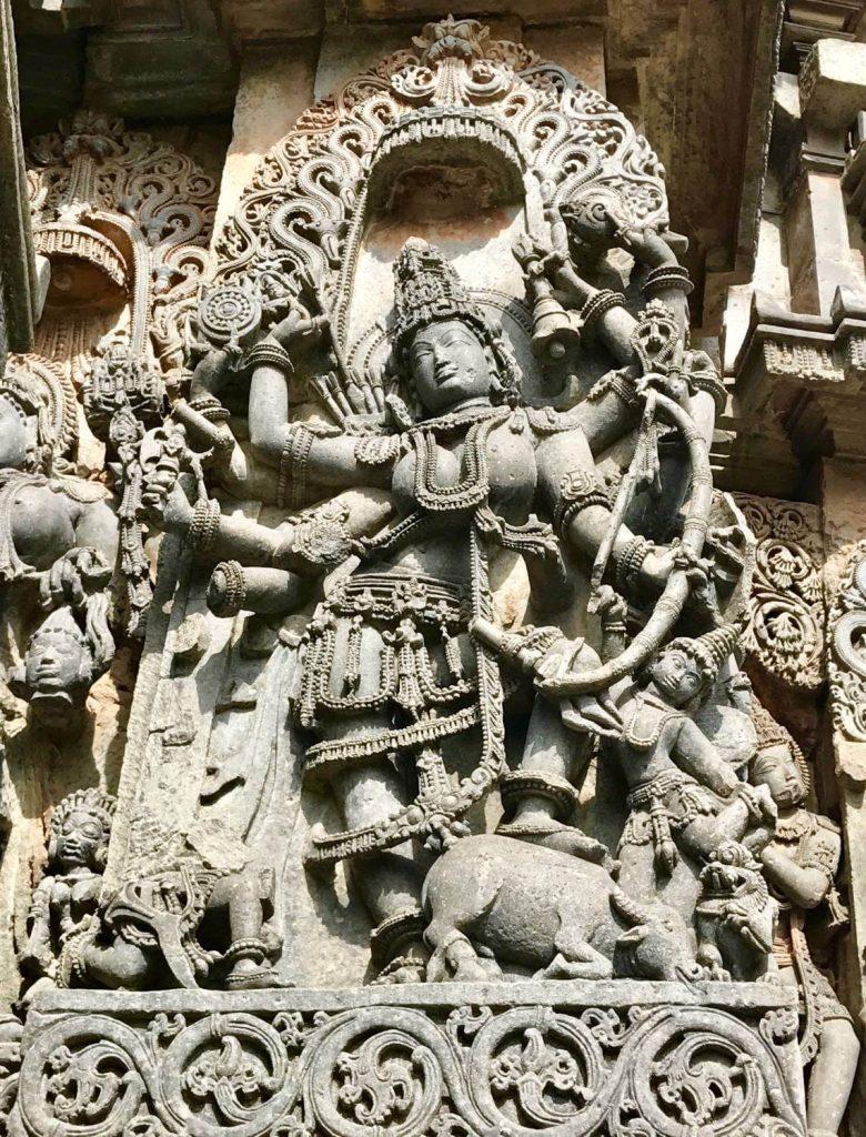 Durga as Mahishasuramardini killing the buffalo demon. Hoysala Empire era sculpture, 12th century. Halebid, Karnataka, India. ©Heather Elton