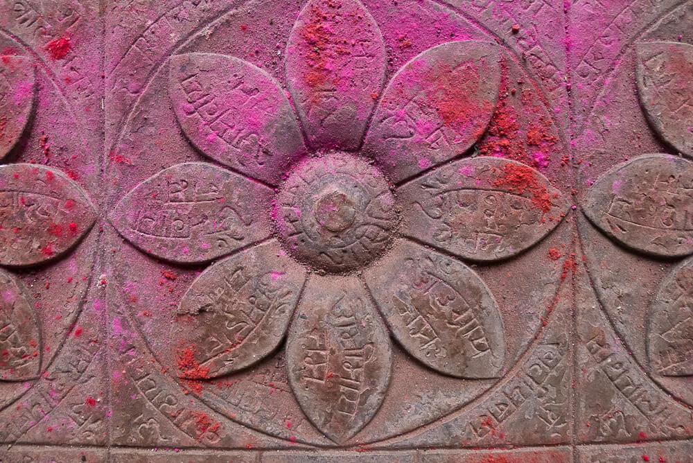 Detail of Vedic altar in the Hindu Math at Bodhgaya with lotus petals and mantras.